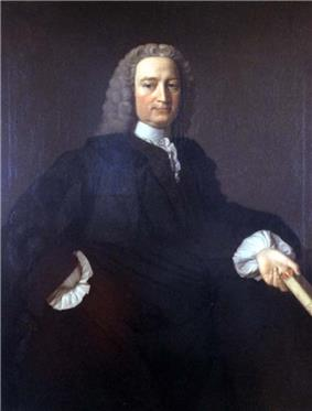A colour painting of a man with white hair that may be a wig, in a dark gown with white sleeves and collar, he holds a book in his hand.