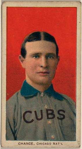 A man with brown hair wearing a grey baseball uniform with a blue collar and the word