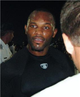 Torso shot of Fred Taylor, a 30-ish African-American man, in black t-shirt.