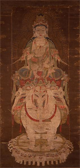 Frontal view of a deity seated on a three-headed white elephant.