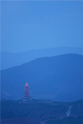 A giant pagoda after sun set in Chuxiong