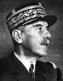 A black and white photo of a man, looking to the right.