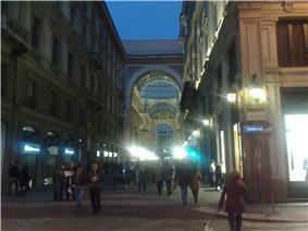 A gallery can be seen here in Milan at night.
