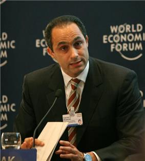 Man talking into a microphone at the World Economic Forum