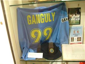 A blue coloured T-shirt displayed at a store window. The T-shirt has the words