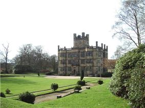 Large Jacobean three-storey house in landscaped grounds