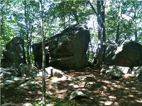 Sun-dappled stone formation