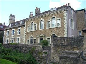 Two-storey houses behind wall