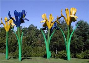 Fibre glass sculpture depicting four giant flowers, two blue and two yellow