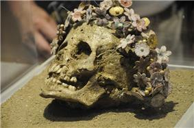 Girl buried with a crown of ceramic Myrtle flowers.jpg