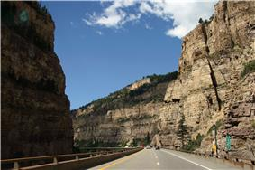 A railroad, river and two-tiered highway following a narrow canyon