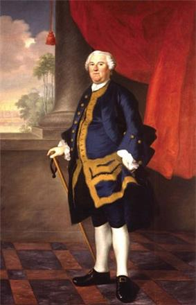 A full length portrait of Benning Wentworth. He faces left, looking toward the painter. Dressed in a blue suit, his right hand rests on a cane. In the background is a window through which a tropical view is visible.