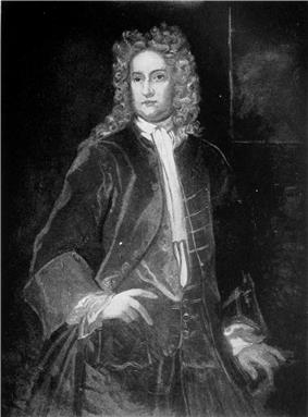 Grayscale image of a man in allonge wig, waiscoat and coat standing with hand on hip