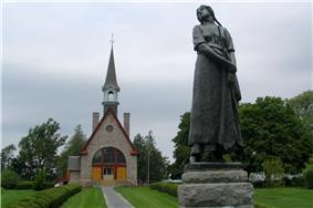 Statue of Longfellow's Evangeline (by Louis-Philippe Hébert) and memorial church.