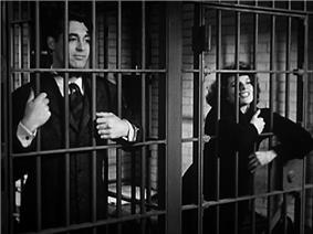 Cary Grant and Katharine Hepburn in adjacent jail cells