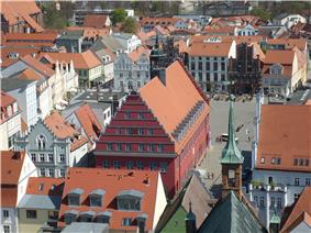 City hall seen from the Greifswald cathedral, fish market in the foreground, market square in the background