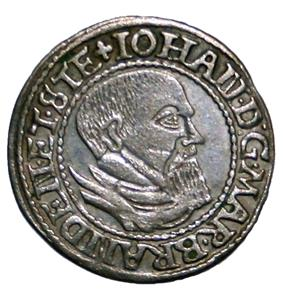 A silver coin showing the head of a bearded man, surrounded by the text 'Iohan DG Mar Branden et Ste'