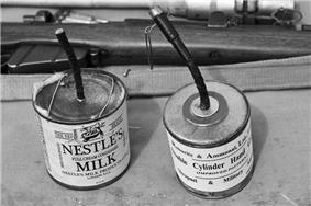 Trench improvised explosive device in a milk tin and a similar manufactured double cylinder grenade (A Great War Society munition)