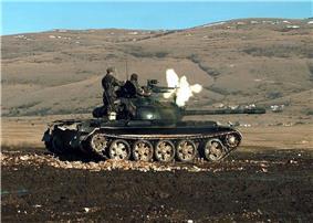HVO Army T-55 Glamoc firing MG.jpg