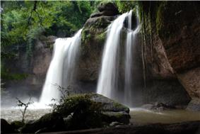 Medium sized waterfall in a tropical forest.
