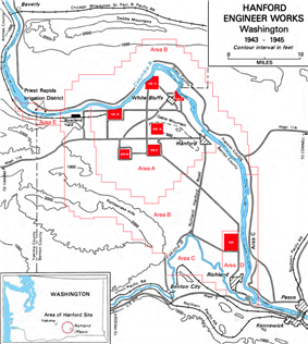 A contour map showing the fork of the Columbia and Yakima rivers and the boundary of the land, with seven small red squares marked on it