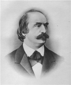 A balding white man aged about 40 with a moustache