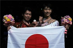 Yuzuru Hanyu (right) and Tatsuki Machida (left) at the 2014 World Championships.