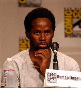 Harold Perrineau behind the microphone at a convention.