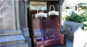 Test seats, which replicate those present on the ride vehicles, exist at the entrance of the queue to ensure potential riders will be comfortable when seated.