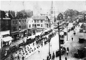 Hartshorn's Market c. 1920. Behind it are the United Church of Norwood and (faintly) St. Catherine's Church, both still standing