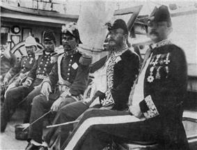 men in 19th-century dress navy uniforms