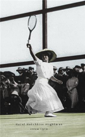 A woman in all white attire is hitting a backhand with the tennis racket in the right hand, which it is a black and white photograph