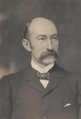 A black and white portrait of H. B. Higgins