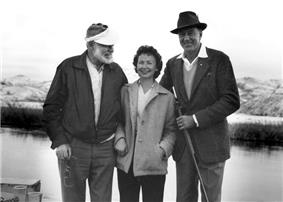 photograph of two men and woman