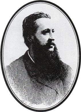 head and shoulders shot of a middle-aged man with a beard looking to the right