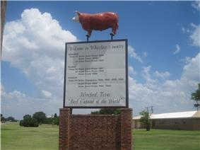 Hereford welcome sign on U.S. Highway 385; click to read.