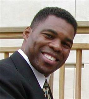 A picture of Herschel Walker posing.
