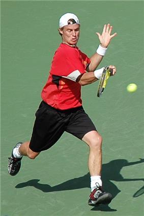 Lleyton Hewitt hitting a tennis ball
