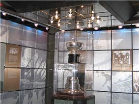Trophy bowl and base in glass case