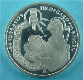 German 10 DM commemorative coin issued by the Federal Republic of Germany (1998): Hildegard of Bingen writing the book (Liber), 'Sci vias Domini', inspired by the hand of the Lord