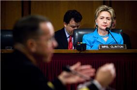 Clinton listening at a Senate hearing