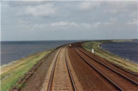 The Hindenburgdamm Rail Causeway across the Wadden Sea to the island of Sylt in Schleswig-Holstein, Germany