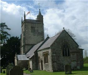 Small stone church with square tower