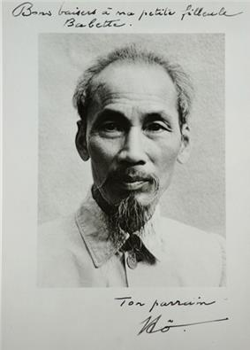 A thin-faced man with a long beard wearing traditional clothing