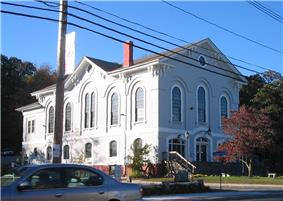 Holliston Town Hall on the east border of the town green