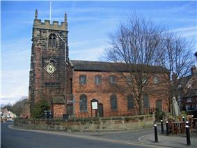 A church with a Neoclassical brick body and a stone Gothic tower