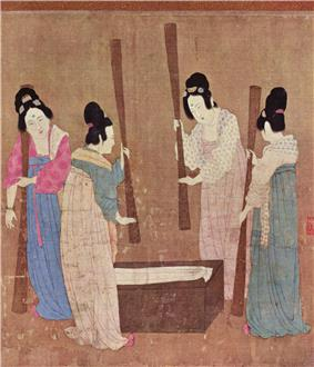 A painted image of four Chinese women wearing colorful silk robes, their hair tied up into buns, standing around a small wooden block with silk laid on top while holding large whisks which they use to beat the silk