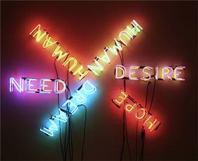 Six words are spelled out using neon tube lights. Each word is spelled in a different color of light; the words are roughly laid out like six spokes of a wheel. The six words are NEED, HUMAN, HUMAN, DESIRE, HOPE, and DREAM.