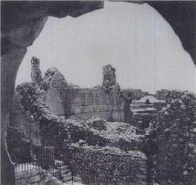 The synagogue without its roof, lies open to the elements, with only its lower walls left standing
