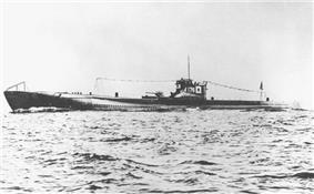 A large submarine underway. Japanese flags and the number